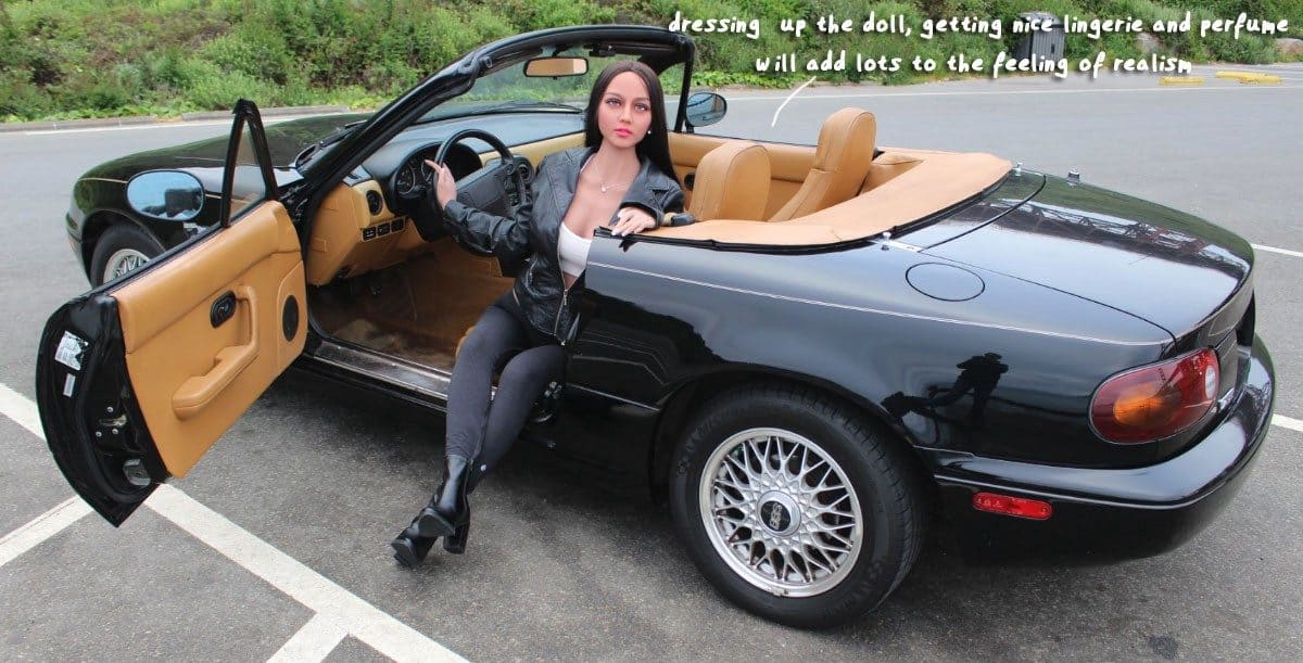life-like sex doll posing in car