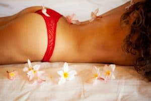 flowers and topless girl in red lingerie